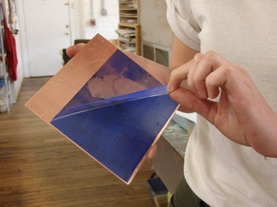 Peeling the ironed, rinsed film from the plate